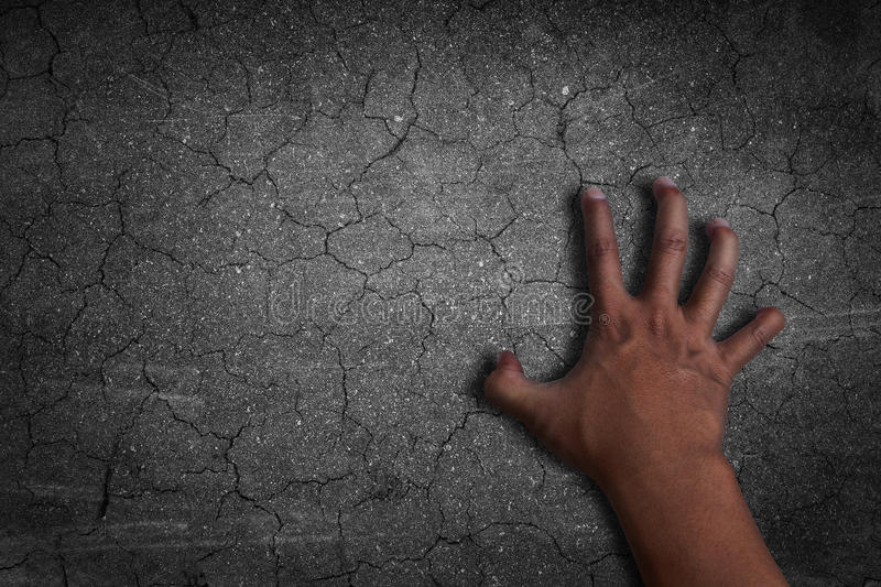 Hand of Darkness. Cracked black background royalty free stock photos