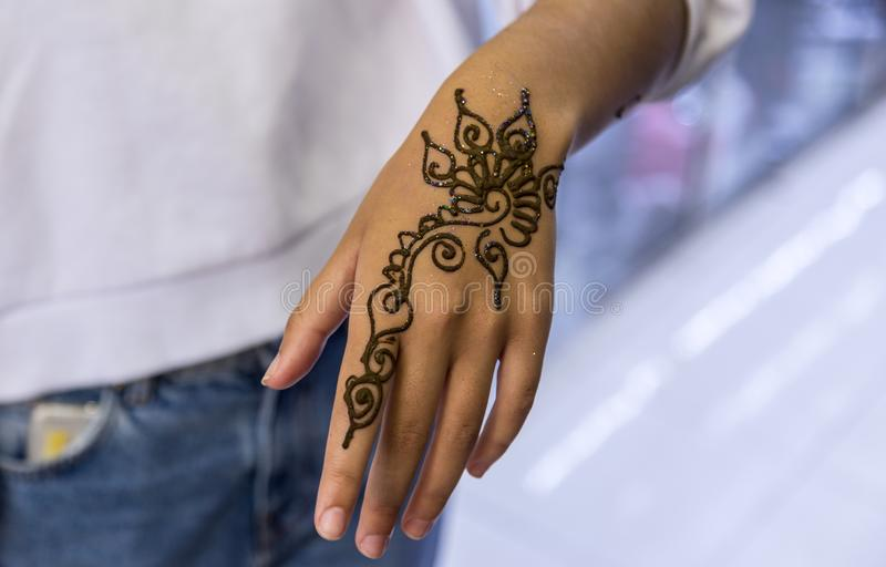 Hand with decorative henna design stock photo