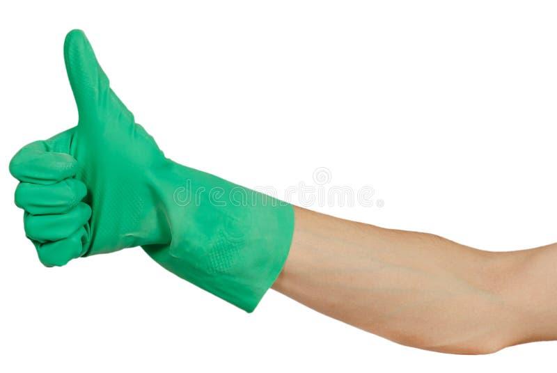 Hand in der grünen Gummihandschuhshow greift oben ab stockfotos