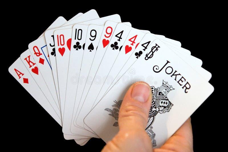 Hand der Karten stockbild