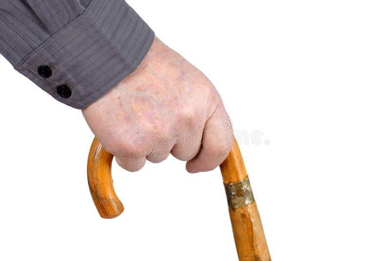 Hand des Älteren, die mit Stock geht lizenzfreies stockfoto