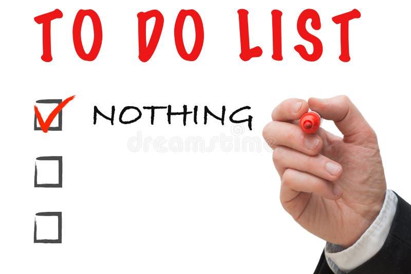 Hand des Büroangestellten mit dem Markierungsschreiben, zum der Liste zu tun: Nichts stockfoto