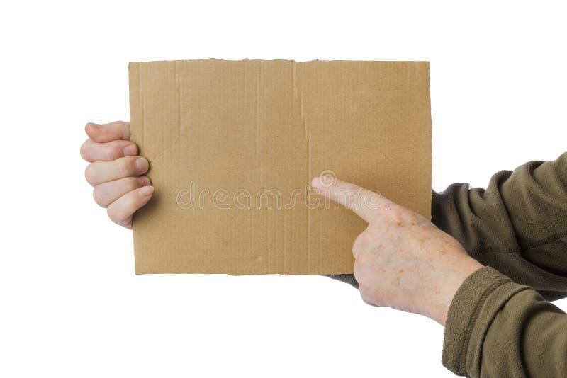 Hand des Bettlers mit Pappe lizenzfreie stockfotografie