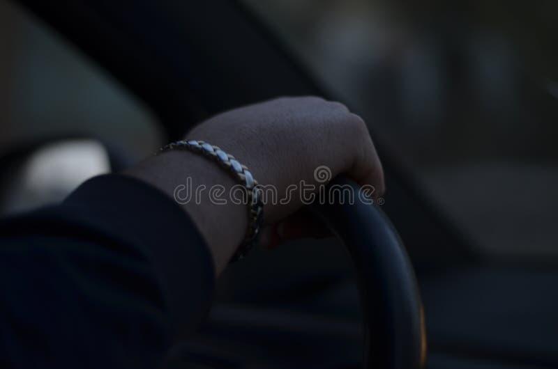 Hand des Fahrers stockbilder