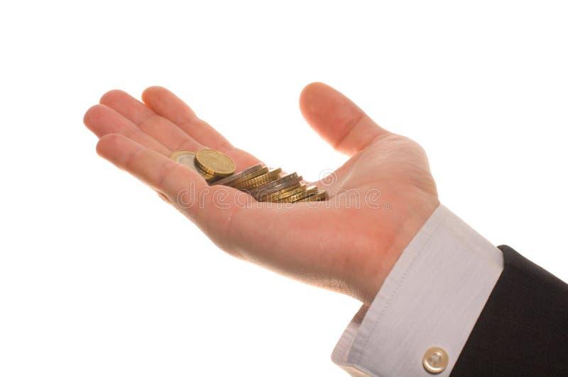 Hand des Geschäftsmannes mit Euromünzen lizenzfreies stockbild