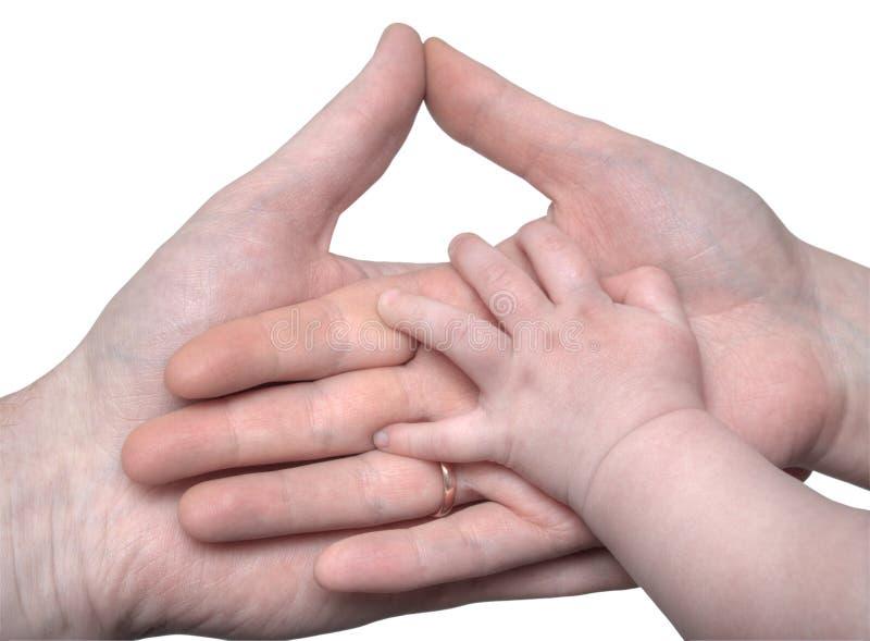 Hand des Schätzchens, welche die Hände der Muttergesellschaft anhält lizenzfreie stockfotografie