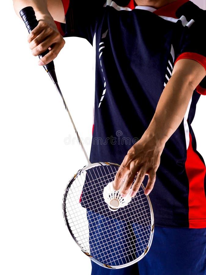 Hand des Spielers mit Schläger und Federball lizenzfreies stockfoto