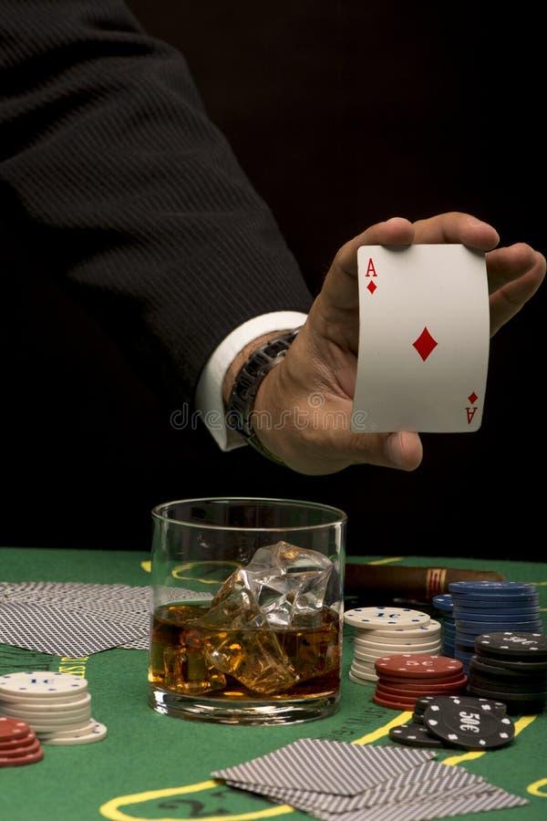 Hand with diamond ace stock photos