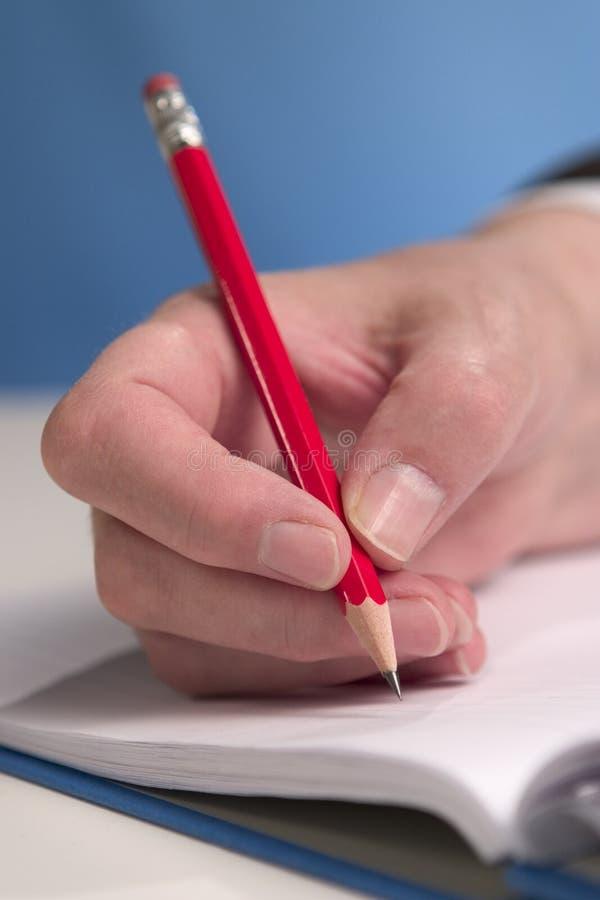 Hand die 2 schrijft stock afbeelding
