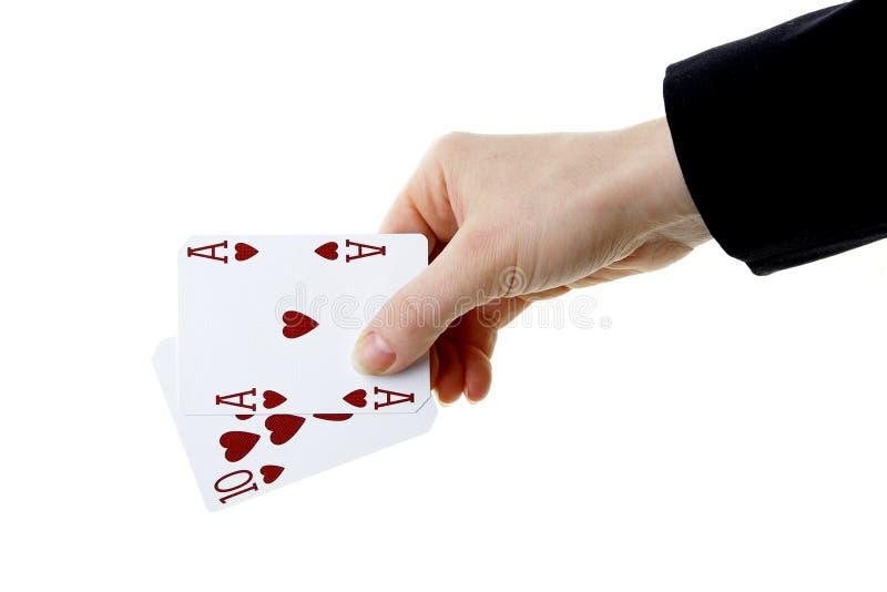 Hand die beste klassieke blackjackcombinatie tien en aas van h houden stock afbeeldingen
