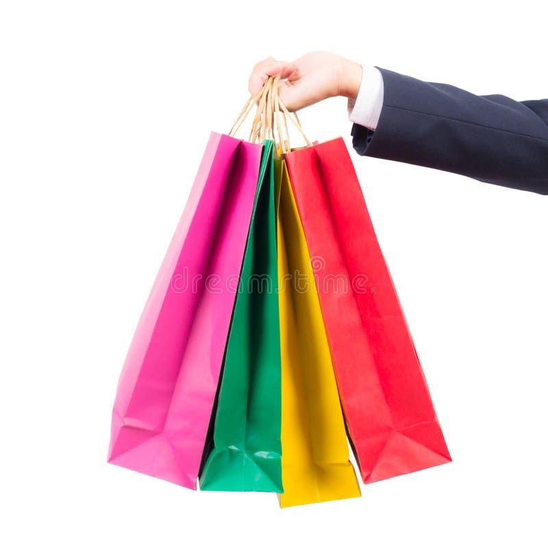 Hand, die bunte Einkaufenbeutel anhält stockbild