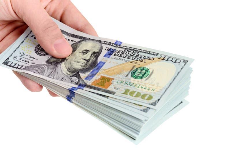 Hand, die 100 Dollarscheine anhält stockbild