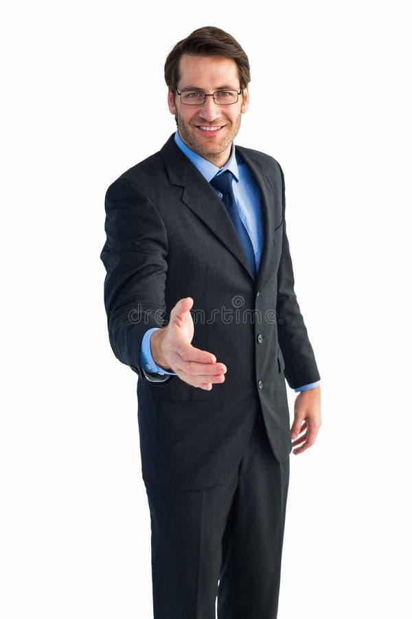 Hand die door glimlachende zakenman worden aangeboden royalty-vrije stock afbeeldingen
