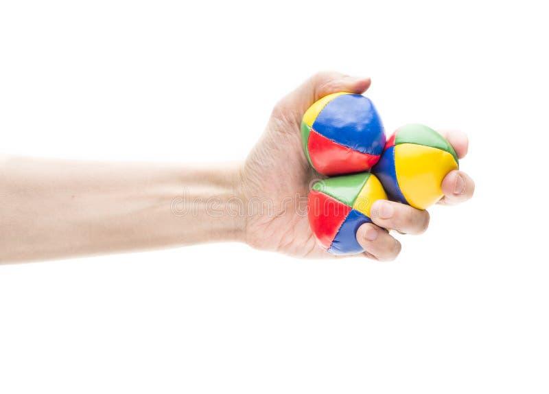 Hand die drie het jongleren met ballen houden royalty-vrije stock afbeeldingen
