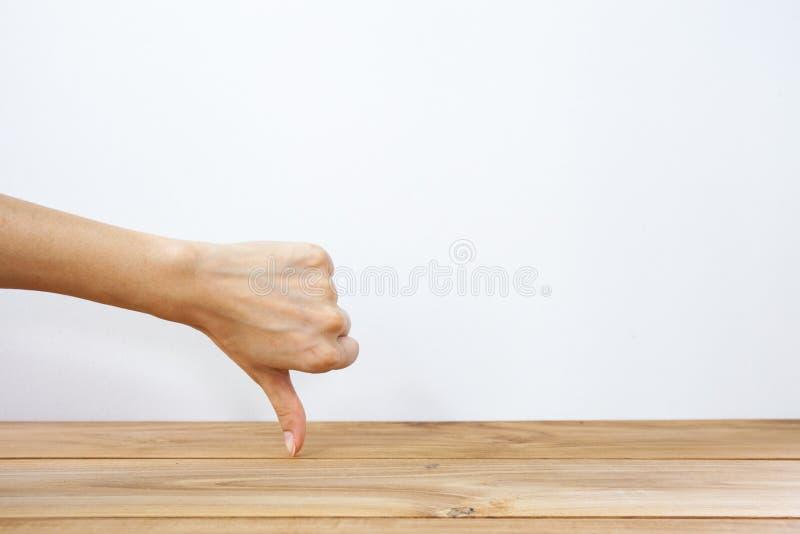 Hand die duim neer tonen royalty-vrije stock afbeeldingen