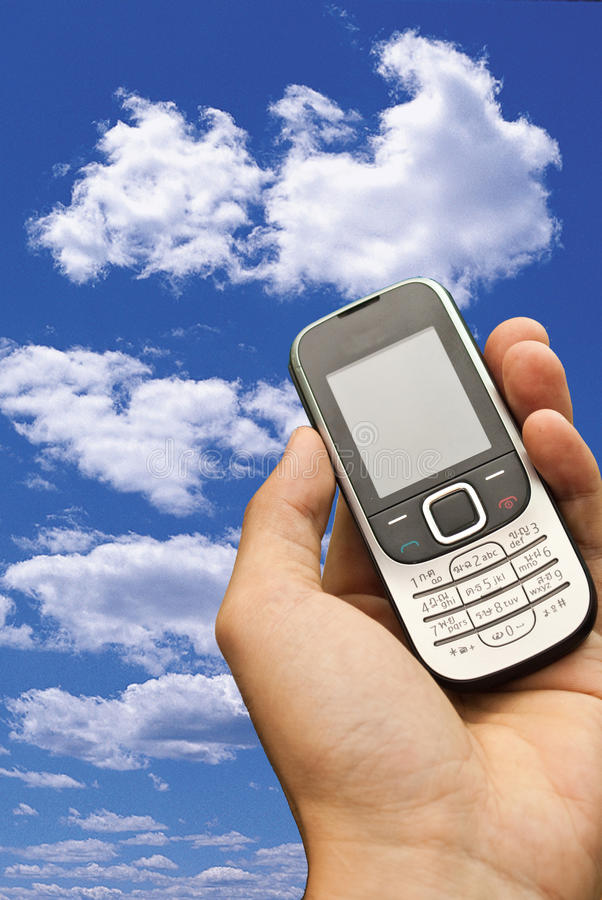 Hand die een celtelefoon houdt royalty-vrije stock afbeelding