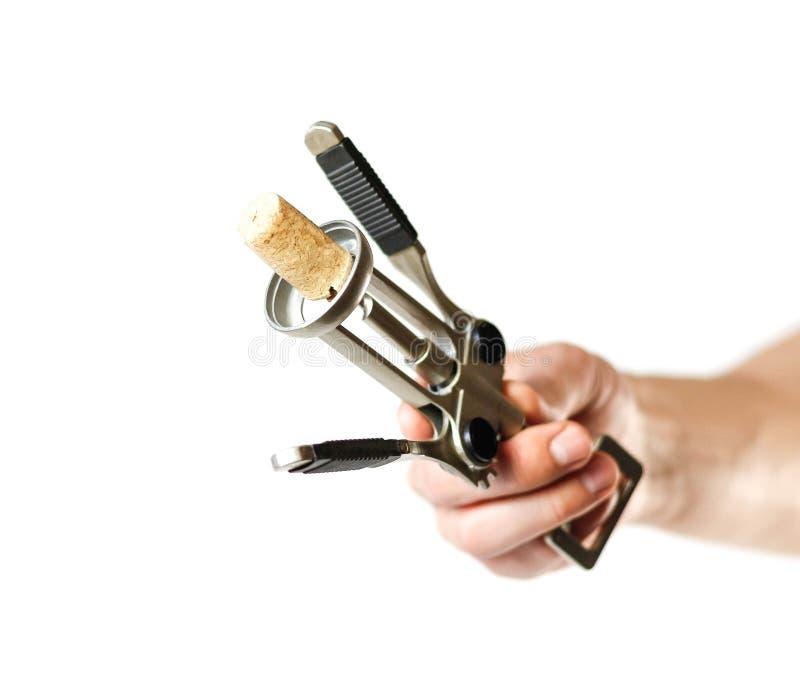Hand die een kurketrekker houden Sluit omhoog Ge?soleerdj op witte achtergrond stock fotografie