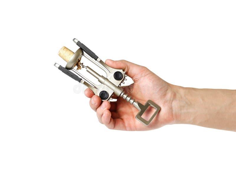 Hand die een kurketrekker houden Sluit omhoog Ge?soleerdj op witte achtergrond royalty-vrije stock afbeelding