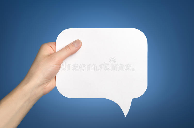 Hand die een lege toespraakbel houden stock afbeeldingen