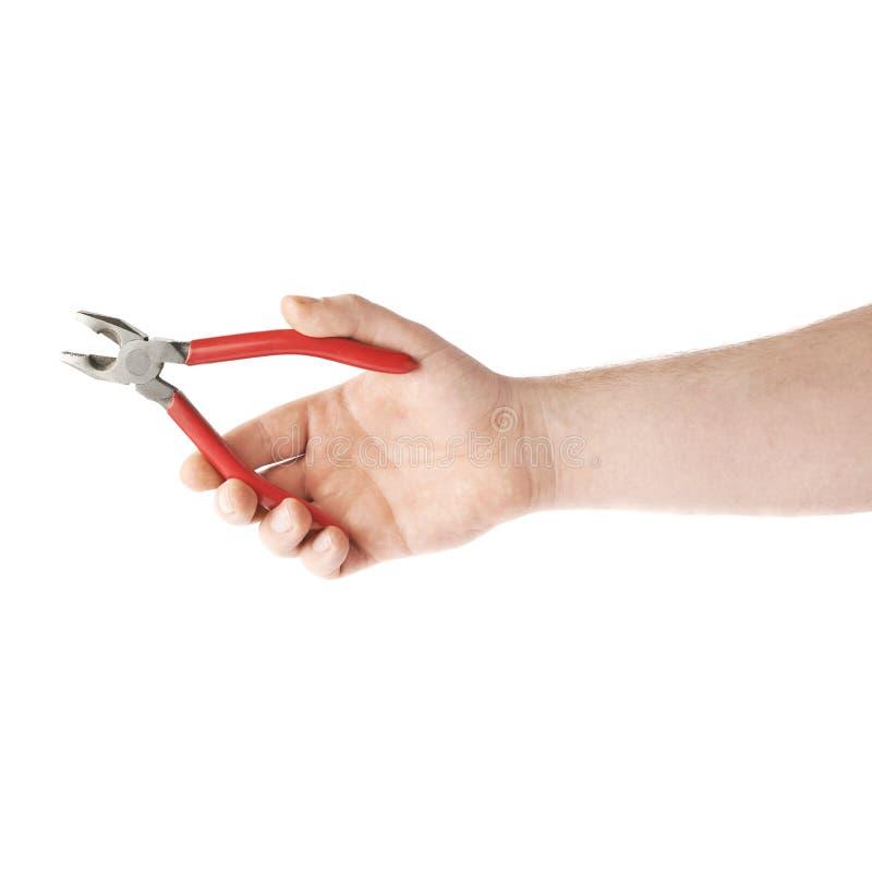 Hand die een meer plier hulpmiddel, samenstelling houden die over de witte achtergrond wordt geïsoleerd royalty-vrije stock afbeeldingen