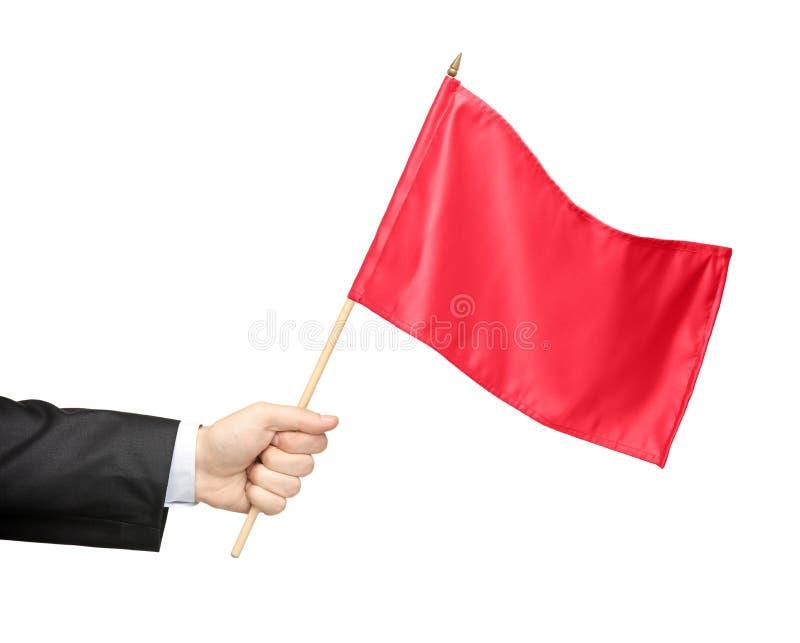 Hand die een rode vlag houdt royalty-vrije stock afbeelding