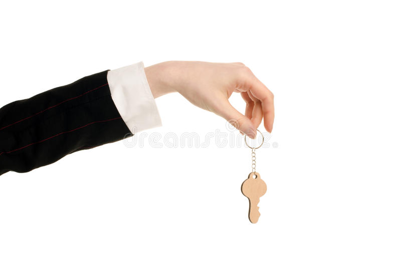Hand die een sleutel houden. stock foto's