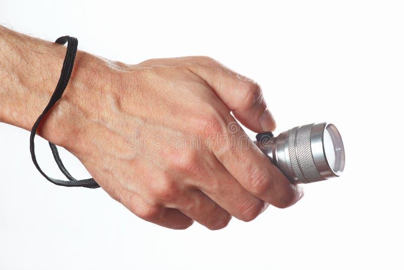 Hand die een toorts op witte achtergrond houden royalty-vrije stock afbeeldingen