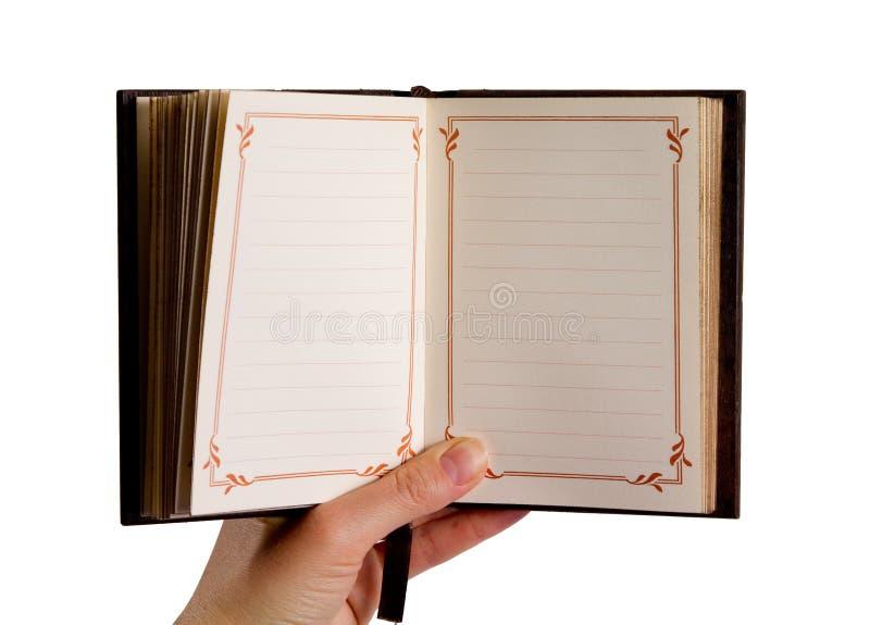 Hand die een uitstekend dagboek houdt stock foto's