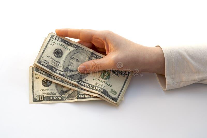 Hand die een Ventilator van tien dollars houdt stock foto's