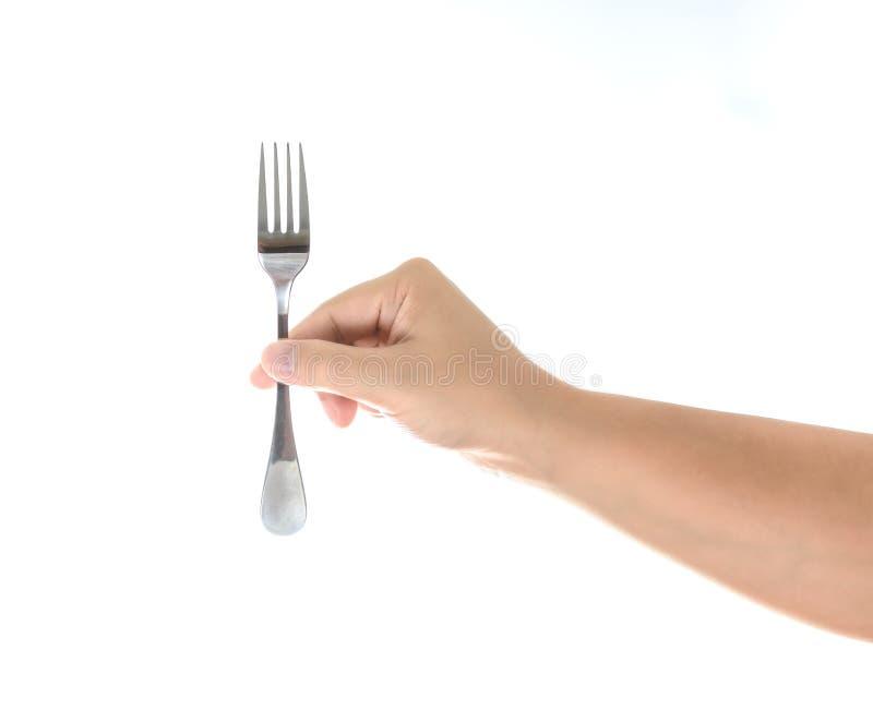 Hand die een zilveren die vork houden op wit wordt geïsoleerd stock foto
