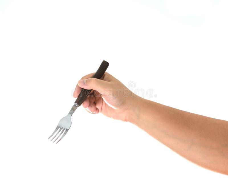 Hand die een zilveren die vork houden op wit wordt geïsoleerd stock fotografie