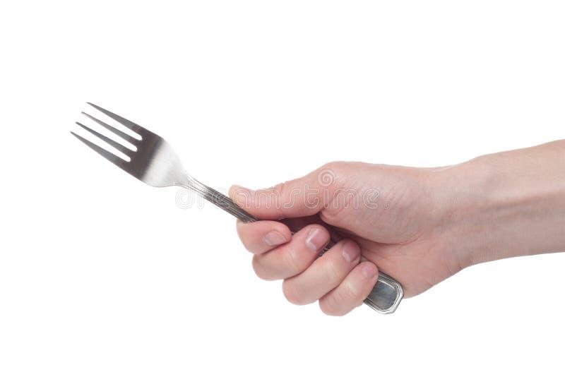 Hand die een zilveren vork op een ge?soleerde witte achtergrond houden royalty-vrije stock foto