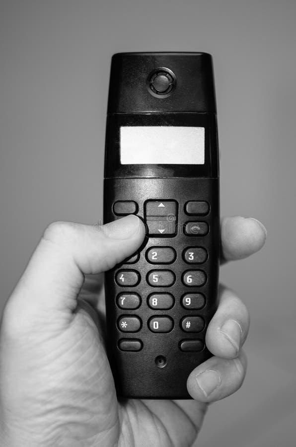 Hand, die ein Haupttelefon hält lizenzfreie stockfotografie