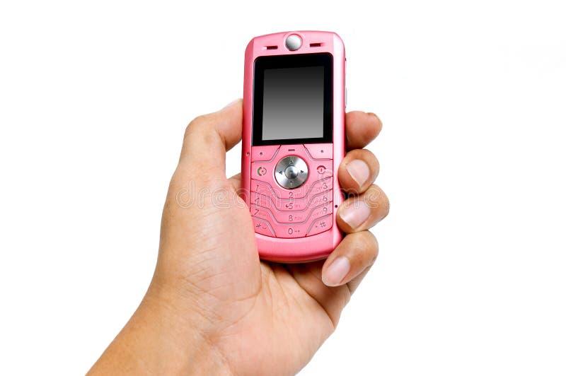 Hand, die ein Mobiltelefon anhält lizenzfreie stockbilder