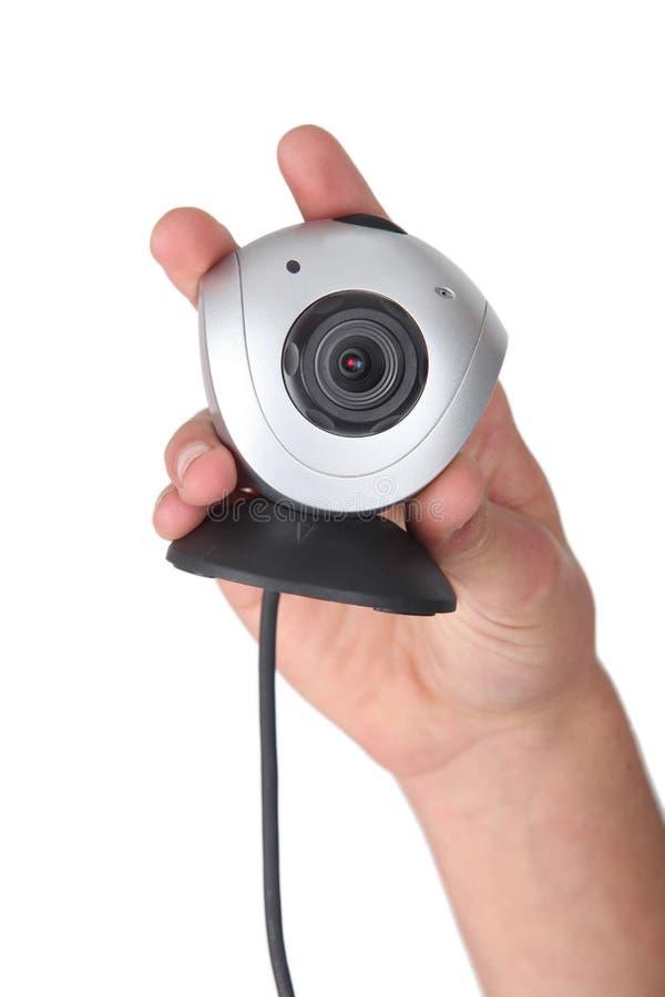 Hand, die ein Webcam hält lizenzfreie stockfotos