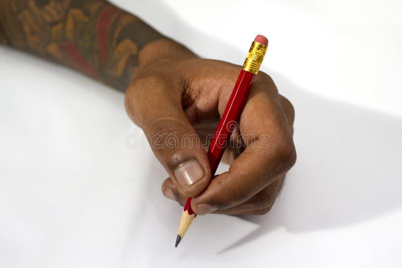 Hand, die einen Bleistift hält lizenzfreies stockbild