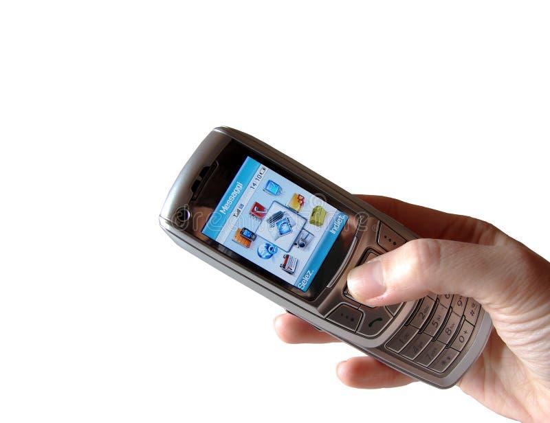 Hand, die einen Handy anhält lizenzfreie stockfotografie