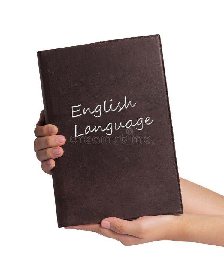 Hand die Engelstalig die boek houden op witte achtergrond wordt geïsoleerd royalty-vrije stock afbeeldingen