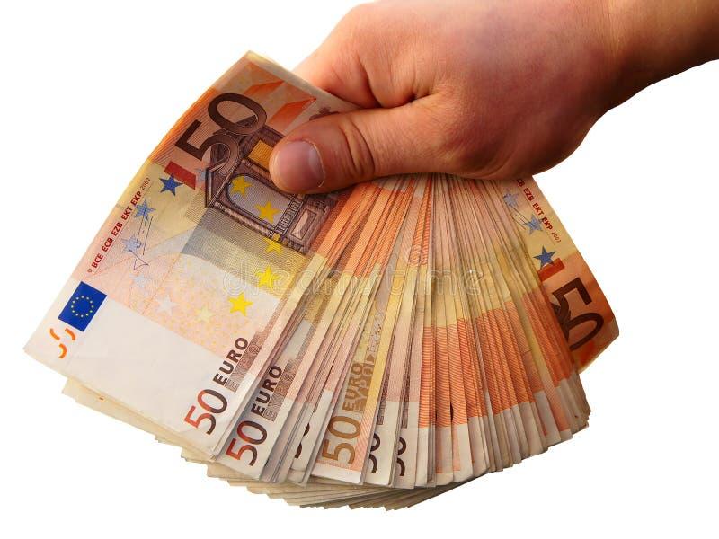 Hand, die Eurobanknotegeld gibt stockfotografie