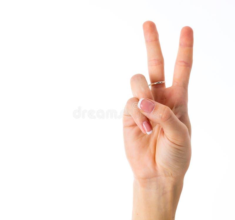 Hand, die Frieden zeigt lizenzfreie stockfotos