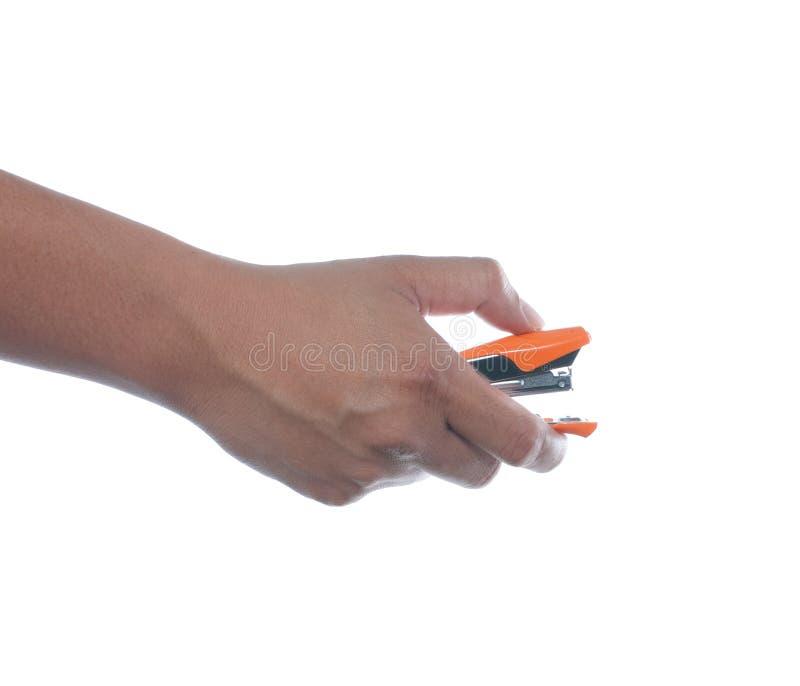 Hand, die Hefter hält stockbilder