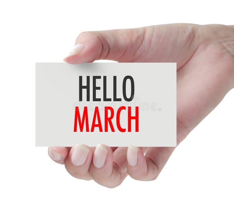 Hand die Hello Maart tonen stock foto