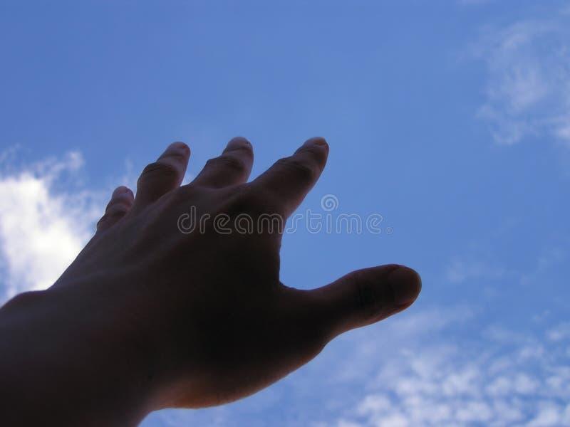 Hand, die heraus erreicht lizenzfreies stockbild