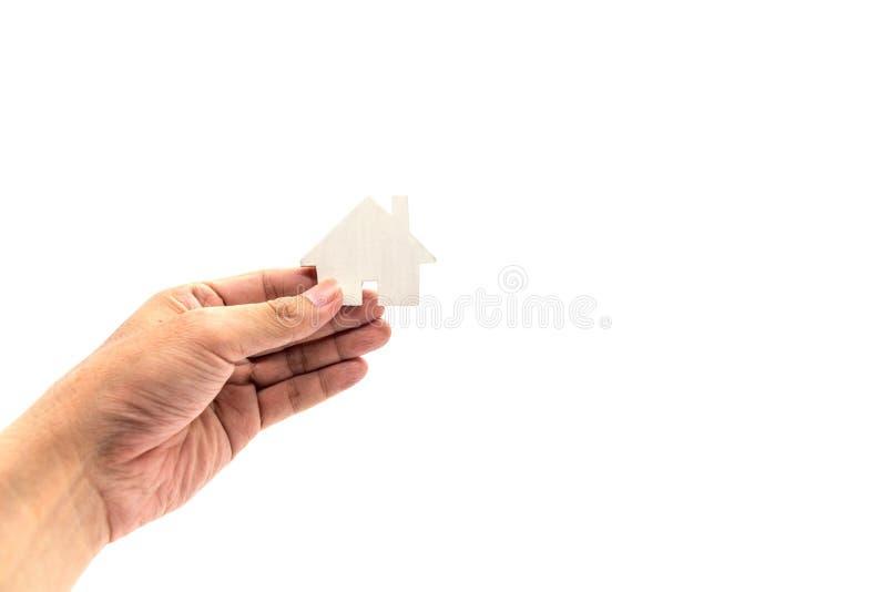 Hand die het concept van het wit huispictogram houden stock afbeeldingen