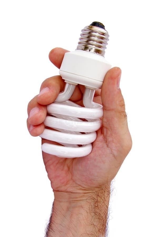 Hand, die kompakte Lampe anhält lizenzfreie stockfotos