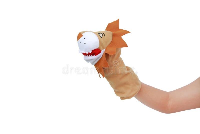 Hand die die Leeuwmarionetten dragen op witte achtergrond, Leeuwhoofd worden ge?soleerd royalty-vrije stock afbeelding