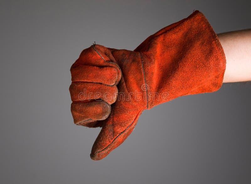 Hand die negativiteit met lassershandschoen uitdrukken stock afbeeldingen