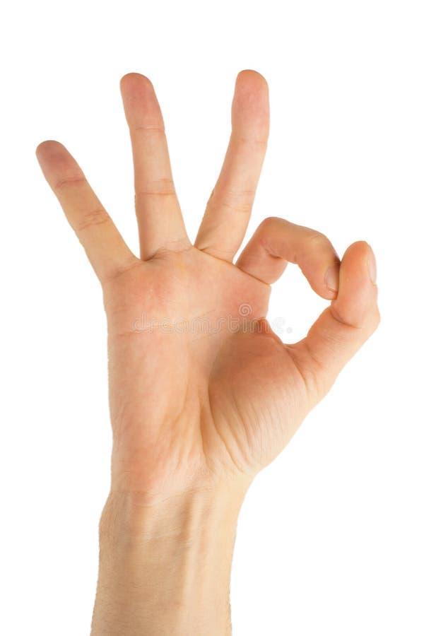 Hand die o.k. benadrukken, ja, goedkeurend handteken, geïsoleerde studio stock afbeelding