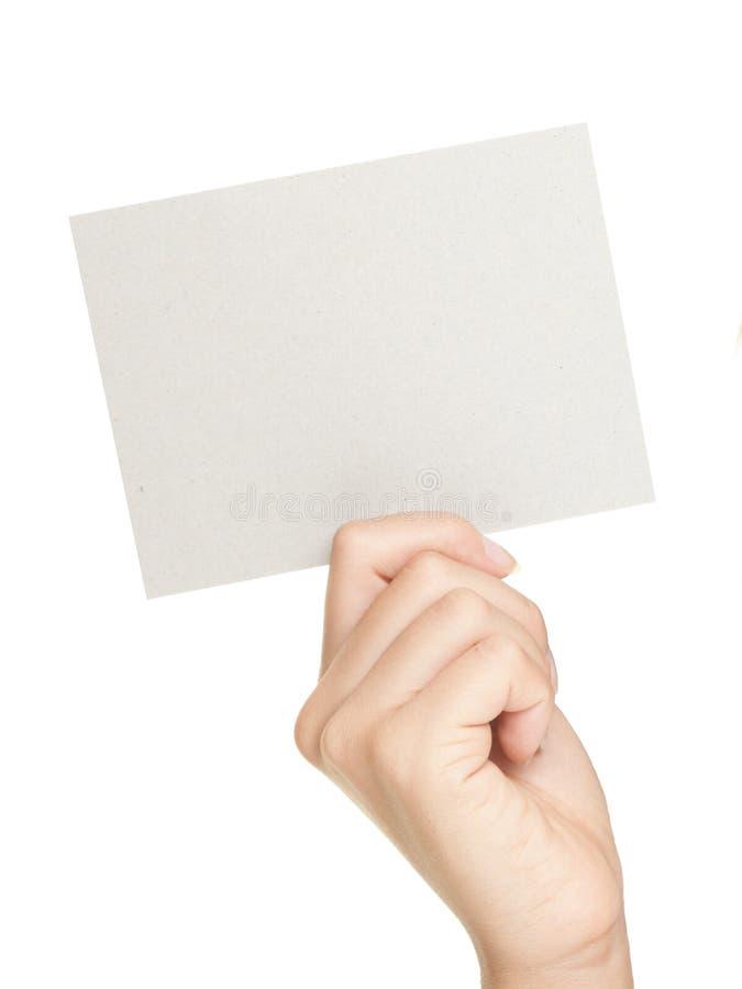 Hand, die Papierzeichen zeigt stockbild