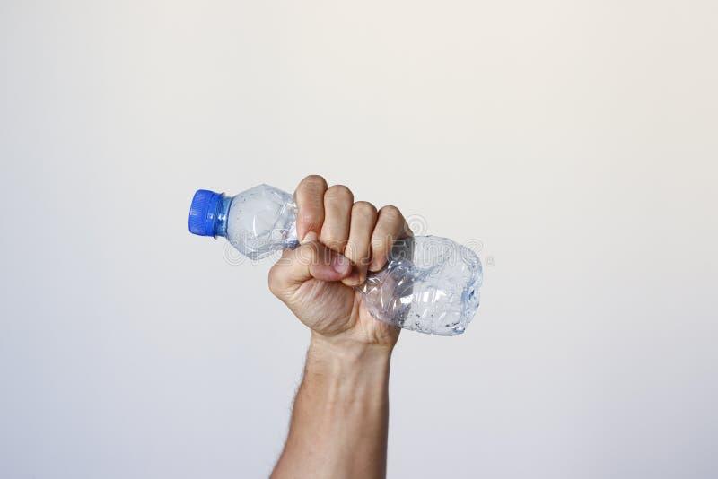 Hand die Plastic Fles drukken stock foto